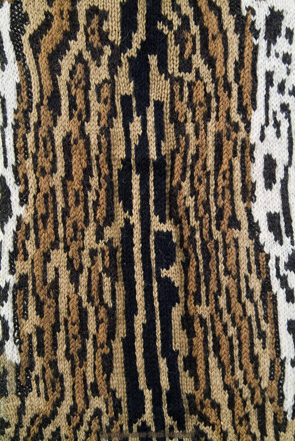 """Photo: #4 Ocelot  2010  50"""" x 29""""  (127cm x 73cm) Hand knitted textile. Interpretation of ocelot based on study of actual pelt at American Museum of Natural History. Female - collected from Venezuela, 1929. Yarn, string, sticks.  (C) Ruth Marshall, 2010."""