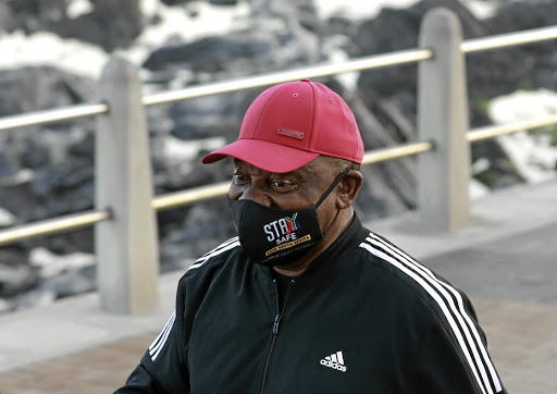 Masked-up: President Cyril Ramaphosa goes for a jog on the Sea Point promenade in Cape Town. Picture: Getty Images/Nardus Engelbrecht
