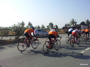 Photo: Lot of orange jerseys(TeamWheelsports) in the peloton..