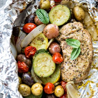 Pesto Pork Chop and Summer Vegetable Foil Dinners Recipe