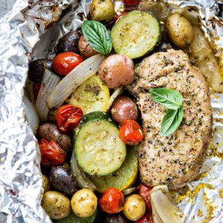 Pesto Pork Chop and Summer Vegetable Foil Dinners.