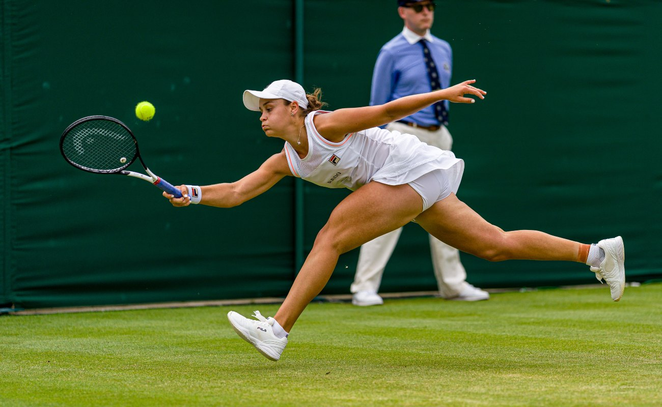 Ashleigh Barty of Australia plays a forehand during Day seven of The Championships - Wimbledon 2019 at All England Lawn Tennis and Croquet Club on July 08, 2019 in London, England. (Photo by Andy Cheung/Getty Images)