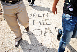 Photo: The graffiti reading 'Open The Road' refers to a blocked roadway reserved exclusively for Jewish settlers in the West Bank village of Kufr Qaddoum. ($100)