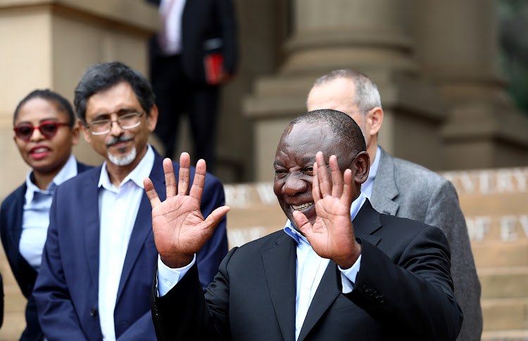 President Cyril Ramaphosa waves after addressing the media on the stairs of the Union Buildings on Sunday, after he engaged political parties and business leaders amid the outbreak of the coronavirus.