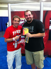 Photo: Scott Prusha of Panini America showing off the wrapper redemptions at the NSCC