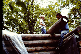 Photo: Getting close to the top of the wall; 11 logs high.