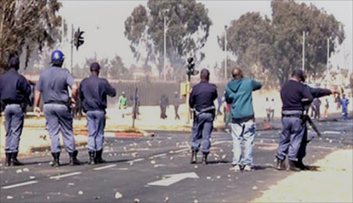 Police  'shoot at residents in  Hawston, Western Cape who where protesting. File photo