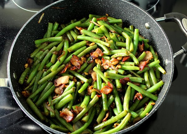 Continue cooking over LOW heat for about 5 minutes.  The beans should remain...
