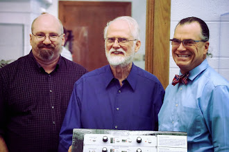 Photo: Mark Smart, Jim Beauchamp, and Scott Schwartz stand in front of the recreated Harmonic Tone Generator at the Sousa Archives - University of Illinois at Urbana Champaign.