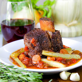 BEEF SHORT RIBS braised with red wine and diced tomatoes