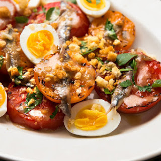 Charred Tomatoes With Egg, Anchovies and Bread Crumbs