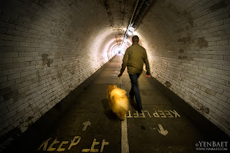 Photo: Walking the Dog at the Greenwich Foot Tunnel - London, UK.  Measuring 1,217 feet in length and approximately 50 feet deep, the Greenwich Foot is the first suspension bridge under the famous river Thames. When it opened in August 1902, its purpose was to allow south London residents to work in the docks on the Isle of Dogs. It is now being are used by 1.5 million people each year.  #GreenwichFootTunnel   #Greenwich   #London   #England   #UK   #Travel   #Photography   © Yen Baet - www.YenBaet.com. All Rights Reserved. Join me on Facebook at www.facebook.com/YenBaetPhotography.