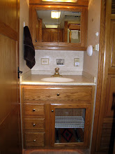 Photo: Bathroom sink and cabinets.
