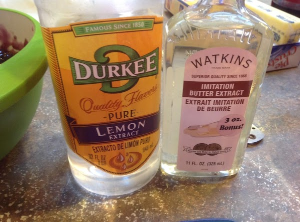 Now add both the butter and lemon extract to the bowl and stir to...