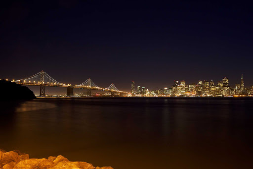 San-Francisco-Skyline-at-Night-from-Treasure-Island - The view of the Bay Bridge and the San Francisco skyline from Treasure Island.