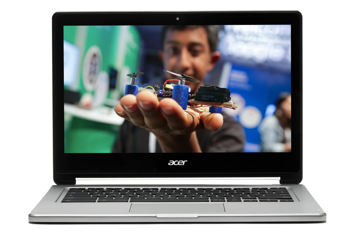 If confidence is what you teach You Chromebook. Image of a Chromebook with a kid showing a mechanical device that he likely made.