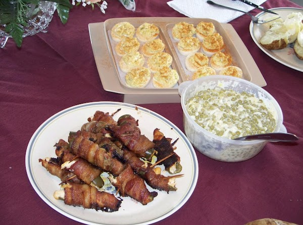 Squeeze the stuffing into the Jalapeno,then wrap the bacon around the Jalapeno. Then put...