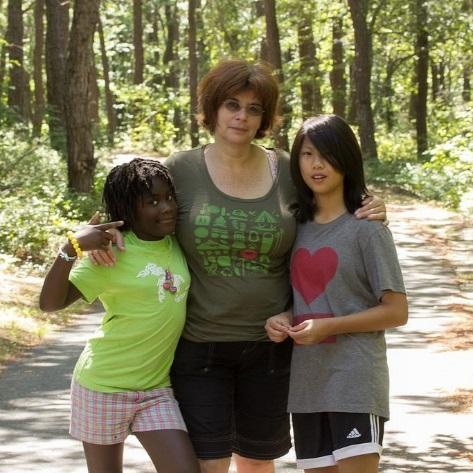 A mother and two adopted daughters.