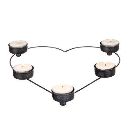 Ljuslykta i stål formad som ett hjärta