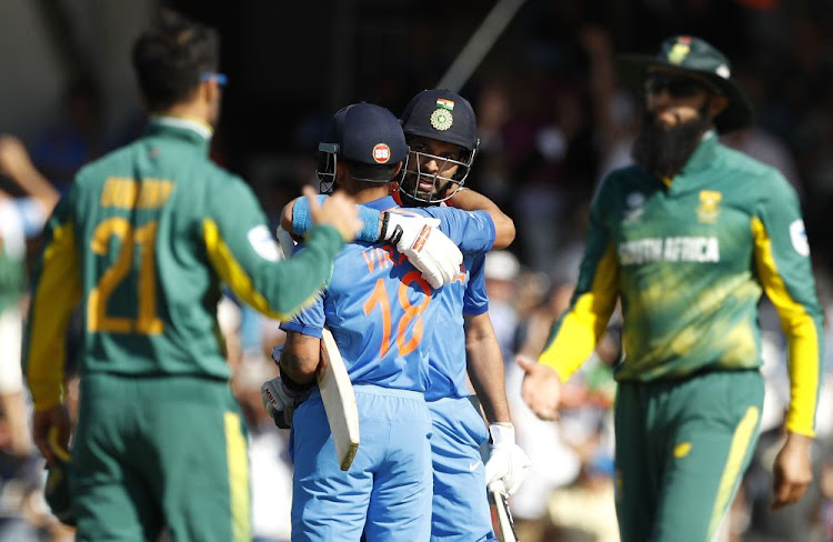 India's Yuvaj Singh (right) celebrates with Virat Kohli at the end of their match against South Africa at the The Oval in Britain on Sunday. Picture: REUTERS