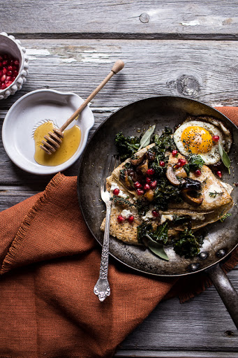 Buttered Hazelnut Crepes with Caramelized Wild Mushrooms, Kale and Pomegranate Goat Cheese.