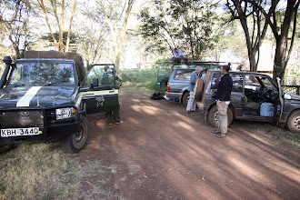 Photo: Part of the team getting ready to leave from Lewa on the first morning (Quentin Luke on his Landrover, Tom Budysnki and Yvonne de Yong next to the Toyota, and Dino Martins next to his car)