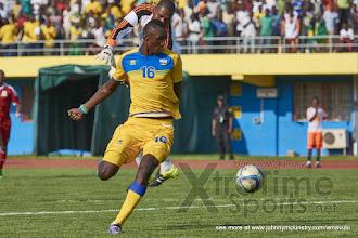 Photo: Ernest SUGIRA steps round the keeper to put Rwanda 3-0 ahead.  [Rwanda v Mauritius, AFCON 2017 Qualifier, 29 March 2016 in Kigali, Rwanda.  Photo © Darren McKinstry 2016, www.XtraTimeSports.net]