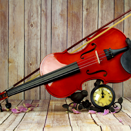 by Dipali S - Artistic Objects Musical Instruments ( concert, petals, orchestra, object, symphony, spring, time, performance, melody, musician, key, closeup, symphonic, music, musical, symbol, clock, art, beautiful, instrument, classical, violin, string, background, artistic )