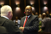 File photo of former President Jacob Zuma speaking to his advocate Mike Hellens after his case was postponed in the PMB High Court for his 3rd appearance on charges of fraud and corruption on July 27 2018.