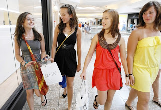 Photo: From left, Sarah Mraz (CQ), 13, Dani Savignac (CQ), 13, Becca Beitscher (CQ), 16, and Stephanie Rotgers (CQ), 16,  carry their shopping bags while walking together at Woodfield Mall Wednesday, August 12, 2010 in Schaumburg, Ill.  (Lane Christiansen/ Chicago Tribune) B58614527Z.1 ....OUTSIDE TRIBUNE CO.- NO MAGS,  NO SALES, NO INTERNET, NO TV, NEW YORK TIMES OUT, CHICAGO OUT, NO DIGITAL MANIPULATION...