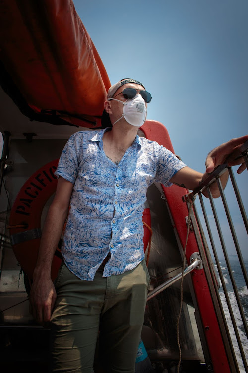 Hugo Kleinhans leaves the cruise ship on a tender (a small boat that is onboard a cruise ship) to get to the Manila harbour