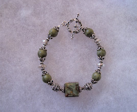 Photo: rhiolite & african grossular granite bracelet