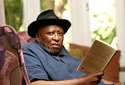 Renowned author Zakes Mda during an interview about his latest novel, The Zulu of New York.  Insert, book cover/  Masi Losi