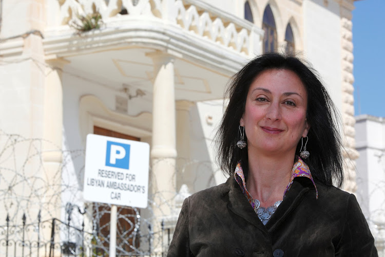 Maltese investigative journalist Daphne Caruana Galizia poses outside the Libyan Embassy in Valletta April 6, 2011. Investigative journalist Caruana Galizia was killed after a powerful bomb blew up a car killing her in Bidnija, Malta, in October 16, 2017. Picture taken April 6, 2011.