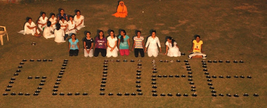 Photo: Formation of word 'GLOBE' with plates by Yajurved girls