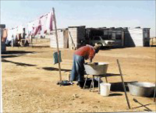 MISERY OVER: Edith Ntombela sold her house to buy another properety but ended up in this shack. 01/08/07. © Sowetan.