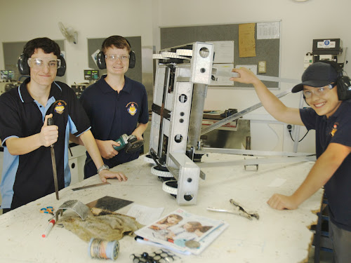 GETTING READY: Helping work on the new Narrabri High School robot are Patrick Loder (Year 11), Callan Webster (Year 10) and Cliff Petersen (Year 9).