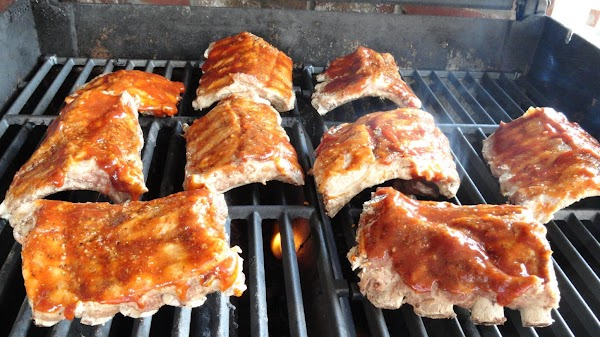 Add ribs to BBQ and brush top side with sauce immediately.