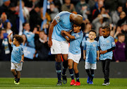 Manchester City captain Vincent Kompany with family during a lap of appreciation after the Premier League match against Leicester City at the Etihad Stadium in Manchester on May 6 2019.