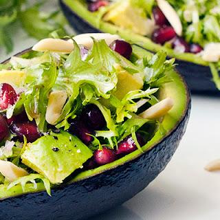 Avocado and Pomegranate Frisée Salad.