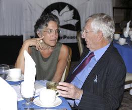 Photo: Advisory board member Phyllis Bennis chats with keynote speaker Seymour Hersh