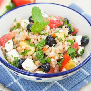 Fruit, herb and feta Israeli couscous salad.
