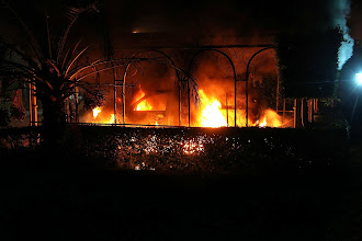 Photo: A car vehicle burns after it was set on fire inside the US consulate compound in Benghazi late on September 11, 2012. An armed mob protesting over a film they said offended Islam, attacked the US consulate in Benghazi and set fire to the building, killing one American, witnesses and officials said.          AFP PHOTO        (Photo credit should read STR/AFP/GettyImages)