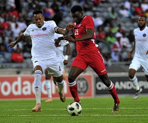 Happy Jele of Orlando Pirates tackles Nekundi Panduleni of African Stars during their Caf Champions League match at Orlando Stadium on Saturday 17 December 2018