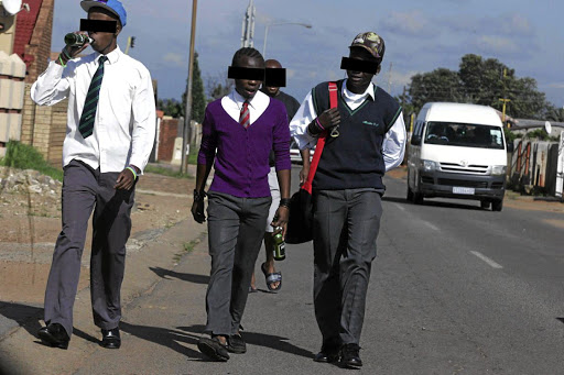 Pupils drinking alcohol while walking township streets.