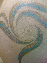 "Photo: The egg's title is ""Ocean(egg)raphy. My client has gone with an underwater theme, and there will be many fun elements - shells, undersea creatures, and water elements. This is the first - a nautilus shell with swoops of current around it. First step: drawing the outlines, and painting the swoops, soon to be covered with tempered glass."