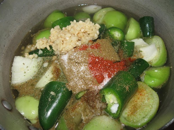In large pot add halved tomatillos, chunked onion, oregano,chuncked jalapeno and serrano*peppers,minced garlic,ground cumin,salt,cayenne...