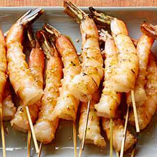 Grilled Shrimp Skewers with Soy Sauce, Fresh Ginger and Toasted Sesame Seeds.