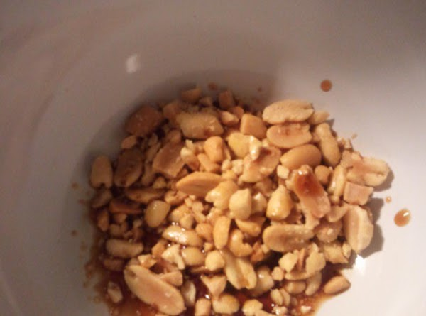 Now place peanuts in plastic sandwwich baggie, hold open end closed with one hand,...