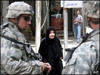 _44006902_troops_woman_ap203b.jpg